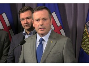 United Conservative Party Leader Jason Kenney speaks to reporters as Edmonton-Riverbend Conservative MP Matt Jeneroux looks on at the party's founding convention at the Sheraton Hotel in Red Deer on Friday, May 4, 2018.