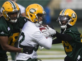 Blair Smith, left, Alex Taylor, middle and Nick Taylor (39) take part in an Edmonton Eskimos practice at Commonwealth Stadium, in Edmonton Monday June 4, 2018.