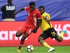 (FILES): This July 20, 2017 file photo shows Canada's Alphonso Davies (L) and Jamaica's Kemar Lawrence (R) fighting for the ball during their CONCACAF tournament quarterfinal match at the University of Phoenix Stadium in Glendale, Arizona.  Vancouver Whitecaps starlet Alphonso Davies has joined Bayern Munich in a record-breaking $13 million deal, the highest transfer fee ever paid for a Major League Soccer player, it was confirmed on Wednesday, July 25, 2018. Davies, who turns 18 in November, has signed a contract which runs from January 2019 until June 2023, the two clubs confirmed.  / AFP PHOTO / Robyn BeckROBYN BECK/AFP/Getty Images
