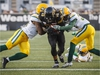 Hamilton Tiger-Cats' Alex Green scores a touchdown against the Edmonton Eskimos' Christophe Mulumba-Tshimanga, left, and Nicholas Taylor, right, during the first half of CFL football action in Hamilton, Ontario on Thursday August 23, 2018. THE CANADIAN PRESS/Mark Blinch ORG XMIT: MDB106