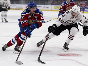 The Edmonton Oil Kings winger Trey Fix-Wolansky (27) battles the Red Deer Rebels defenceman Alexander Alexeyev (4) during first period WHL action at Rogers Place, in Edmonton Friday Sept. 21, 2018.