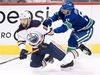 Vancouver Canucks defenseman Troy Stecher (51) fight for control of the puck with Edmonton Oilers Josh Currie during first period NHL pre-season action at Rogers Arena in Vancouver, Tuesday, Sept, 18, 2018. THE CANADIAN PRESS/Jonathan Hayward ORG XMIT: JOHV104