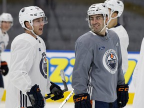 (left to right) Drake Caggiula and Evan Bouchard take part in an Edmonton Oilers practice at Rogers Place, in Edmonton Friday Oct. 26, 2018. Photo by David Bloom