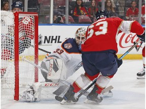 Goaltender Cam Talbot #33 of the Edmonton Oilers stops a shot by Evgenii Dadonov #63 of the Florida Panthers at the BB&T Center on November 8, 2018 in Sunrise, Florida.