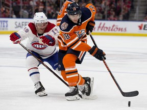 The Edmonton Oilers' Ryan Strome battles the Montreal Canadiens' Max Domi during third period NHL action at Rogers Place, Tuesday, Nov. 14, 2018