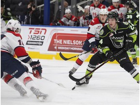 The Edmonton Oil Kings' Brett Kemp (24) battles the Lethbridge Hurricanes' Noah Boyko (19) during first period WHL action at Rogers Place, in Edmonton Sunday Oct. 28, 2018.