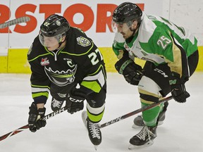 Edmonton Oil Kings captain Trey Fix-Wolansky (left) is checked by Prince Albert Raiders Sean Montgomery during third period WHL hockey game action in Edmonton on Wednesday November 28, 2018.