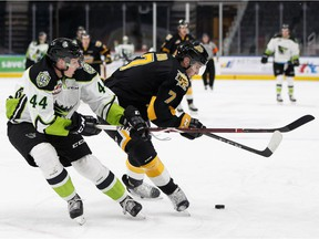 Edmonton's Carter Souch, left, battles Brandon's Vincent Iorio during a WHL hockey game between the Edmonton Oil Kings and the Brandon Wheat Kings at Rogers Place in Edmonton on Tuesday, Jan. 29, 2019.