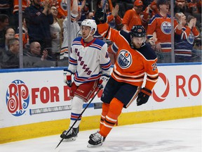 Edmonton Oilers' Leon Draisaitl (29) celebrates Connor McDavid's (97) goal on the New York Rangers during the first period of a NHL game at Rogers Place in Edmonton, on Monday, March 11, 2019.