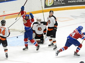 Edmonton Oil Kings Quinn Benjafield (14) and Dylan Guenther celebrate after scoring a goal on Medicine Hat Tigers goaltender Mads Søgaard during Game 4 of the Western Hockey League's Eastern Conference quarter-final on Wednesday, March, 27, 2019 at the Canalta Centre.