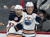 Edmonton Oilers centre Colby Cave(12) celebrates his goal with teammate Josh Currie during third period NHL action against the Ottawa Senators, in Ottawa, Thursday, Feb. 28, 2019. The Oilers defeated the Senators 4-2. THE CANADIAN PRESS/Adrian Wyld ORG XMIT: ajw111