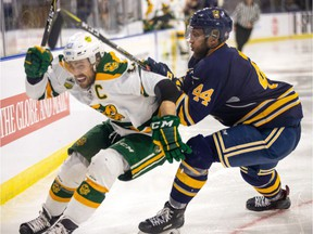 University of Alberta Golden Bears captain Riley Kieser is checked by University of Lethbridge Pronghorn's Evan Wardley during U Cup action Thursday, March 14, 2019 in Lethbridge, Alberta.
