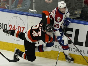 Edmonton Oil Kings David Kope (right) is checked by Medicine Hat Tigers Cole Clayton during first period WHL playoff game action in Edmonton on Saturday March 23, 2019.