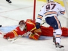 Calgary Flames goalie Mike Smith makes a save on a shot by Connor McDavid of the Edmonton Oilers during NHL hockey at the Scotiabank Saddledome in Calgary on Saturday, April 6, 2019. Al Charest/Postmedia