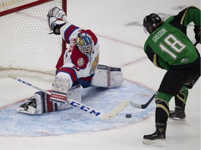 Edmonton Oil Kings goaltender Dylan Myskiw (31) makes a save on Prince Albert Raiders Noah Gregor (18) during first period WHL playoff action on Sunday, April 28, 2019, in Edmonton .