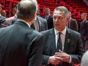 Detroit Red Wings GM Ken Holland talks to the Lindsay family during the public visitation of Ted Lindsay at Little Caesars Arena on March 8, 2019 in Detroit.