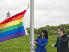The pride flag was raised at the Alberta Legislature grounds on June 7, 2019, by Minister of Culture, Multiculturalism and Status of Women Leela Aheer and city Coun. Sarah Hamilton. Shaughn Butts/Postmedia