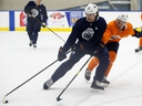 Raphael Lavoie (62) battles Philip Broberg (86) during Billy Moores Cup action at Edmonton Oilers 2019 Development Camp at the Rogers Place Downtown Community Arena in Edmonton, on Thursday, June 27, 2019. Photo by Ian Kucerak/Postmedia