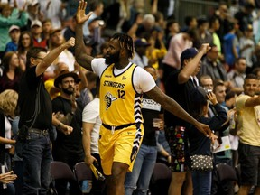 Edmonton Stingers' Akeem Ellis (12) gets the crowd cheering as the final seconds of a 105-99 win ticks down on the Niagara River Lions during CEBL action at Edmonton Expo Centre in Edmonton, on Friday, June 28, 2019.