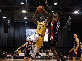 Edmonton Stingers' Mamadou Gueye (3) scores past Fraser Valley Bandits' Jamal Ray (13) during a CEBL game at Northlands Expo Centre in Edmonton, on Thursday, Aug. 1, 2019. Photo by Ian Kucerak/Postmedia
