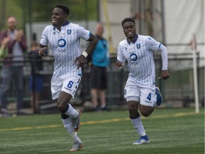 Led by Oumar Diouck, 45, of FC Edmonton, celebrates a first half goal on Pacific FC at Clark Field in Edmonton on August 10, 2019.