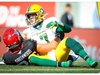 Trevor Harris of the Edmonton Eskimos is tackled by Cory Greenwood of the Calgary Stampeders during CFL football action in Calgary on Monday, September 2, 2019. Al Charest/Postmedia