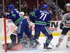 Sep 17, 2019; Vancouver, British Columbia, CAN;  Vancouver Canucks forward Brandon Sutter (20) crashes into the net of Edmonton Oilers goaltender Shane Starrett (40) after an rush on goal and is awarded a penalty shot during the first period at Rogers Arena. Mandatory Credit: Anne-Marie Sorvin-USA TODAY Sports ORG XMIT: USATSI-406620