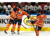 Edmonton Oilers' Connor McDavid (97) celebrates his goal with Darnell Nurse (25) and Matt Benning (83) on Vancouver Canucks' goaltender Jacob Markstrom (25) during third period NHL action at Rogers Place in Edmonton, on Wednesday, Oct. 2, 2019. Photo by Ian Kucerak/Postmedia