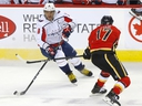 Calgary Flames Milan Lucic battles Washington Capitals Alex Ovechkin in first period NHL action at the Scotiabank Saddledome in Calgary on Tuesday, October 22, 2019.