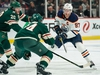 Edmonton Oilers forward Connor McDavid (97) passes around Minnesota Wild defenseman Ryan Suter (20) during the first period at Xcel Energy Center. Brace Hemmelgarn / USA TODAY Sports