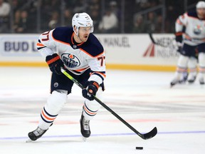 LOS ANGELES, CALIFORNIA - NOVEMBER 21:  Oscar Klefbom #77 of the Edmonton Oilers skates with the puck during the first period of a game against the Los Angeles Kings at Staples Center on November 21, 2019 in Los Angeles, California.