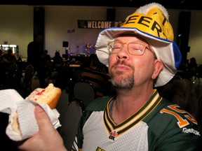 Rod Yaremchuk enjoys a Lobster Roll at the Atlantic Schooners Team Party as thousands of fans join the Grey Cup celebrations at the BMO Centre on Friday, November 22, 2019.