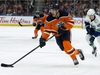 The Edmonton Oilers' Patrick Russell (52) is chased by the Vancouver Canucks' Elias Pettersson (40) during first period NHL action, in Edmonton Saturday Nov. 30, 2019. Photo by David Bloom