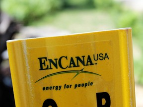 A yellow Encana natural gas pipeline marker is seen in this file photo taken in Kalkaska, Mich., June 20, 2012. The company said on Oct. 31, 2019 that it will move its headquarters to the U.S. from Canada.