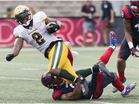 Montreal Alouettes Patrick Levels, bottom, tackles Edmonton Eskimos' C.J. Gable during first half CFL football action in Montreal, Saturday, July 20, 2019.