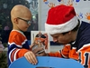 Ben Thomas (5-years-old) gets his jersey autographed by Edmonton Oilers goaile Mike Smith at the Stollery Children's Hospital on Tuesday December 3, 2019. Members of the Edmonton Oilers hockey team made their annual visit to local area hospitals, giving them the chance to bring smiles to people facing trying circumstances during the holiday season. (PHOTO BY LARRY WONG/POSTMEDIA)