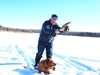 Neil and Penny with a Devil's Lake pike. (Neil Waugh/Edmonton Sun)