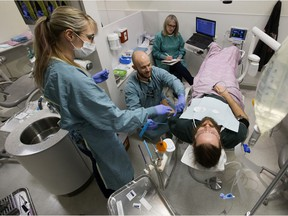 Dr. Don Beeson (from Grande Prairie) works on patient Charles Harker during the U of A School of Dentistry's IV conscious sedation course at the Kaye Edmonton Clinic, 11400 University Ave, in Edmonton Thursday Dec. 19, 2019. Over 80 patients took part in the course which provided approximately 140 treatments free of charge.