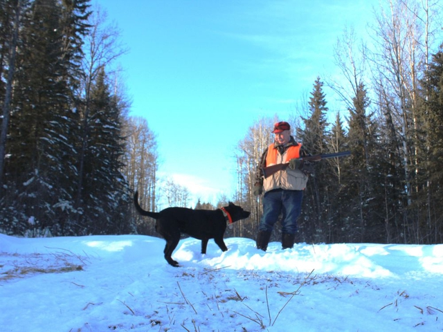 Neil and Stella on a New Year's Day grouse hunt at Lodgepole. Neil Waugh/Edmonton Sun