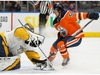 Edmonton Oilers' Kailer Yamamoto (56) skids to a stop in front of Nashville Predators' goaltender Pekka Rinne (35) during first period NHL hockey action at Rogers Place in Edmonton, on Tuesday, Jan. 14, 2020. Photo by Ian Kucerak/Postmedia