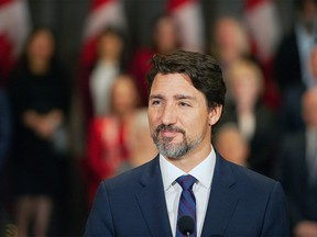 Prime Minister Justin Trudeau stands in front of his cabinet as he speaks to media during the final day of the Liberal cabinet retreat at the Fairmont Hotel in Winnipeg, Tuesday, Jan. 21, 2020. THE CANADIAN PRESS/Mike Sudoma ORG XMIT: WPGX110