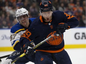 The Edmonton Oilers' Alex Chiasson (39) battles the St. Louis Blues' David Perron (57) at Rogers Place on Friday, Jan. 31, 2020.