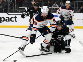 Sam Gagner (89) of the Edmonton Oilers reaches for the puck in front of Matt Roy (3) of the Los Angeles Kings at Staples Center on Feb. 23, 2020, in Los Angeles, Calif.