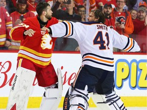 Calgary Flames goalie Cam Talbot and Edmonton Oilers goalie Mike Smith fight during NHL action in Calgary on Saturday, February 1, 2020.