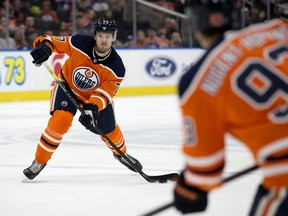 The Edmonton Oilers' Oscar Klefbom (77) makes a pass to Ryan Nugent-Hopkins (93) against the Nashville Predators at Rogers Place on Feb. 8, 2020.