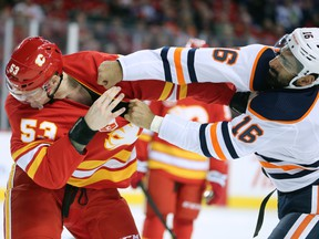 The Calgary Flames' Buddy Robinson trades punches with the Edmonton Oilers' Jujhar Khaira in Calgary on Saturday, Feb. 1, 2020.