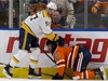 The Edmonton Oilers' Connor McDavid (97) battles the Nashville Predators' Dante Fabbro (57) during second period NHL action at Rogers Place, in Edmonton Saturday Feb. 8, 2020. McDavid skated slowly away from the collision. Photo by David Bloom