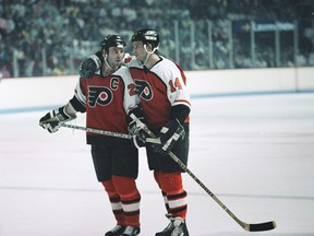 Philadelphia Flyers captain Dave Poulin #20 and teammate Ron Sutter #14 during a break in the action  at the Montreal Forum during the Wales Conference finals in 1987.
