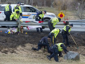 RCMP investigators search for evidence at the location where Const. Heidi Stevenson was killed along the highway in Shubenacadie, N.S. on Thursday, April 23, 2020.