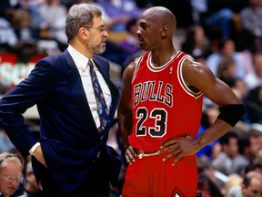 Michael Jordan of the Chicago Bulls  talks strategy with head coach Phil Jackson in Game 6 of the 1996 NBA Finals against the Seattle SuperSonics at the United Center on June 16, 1996 in Chicago Iillinois.